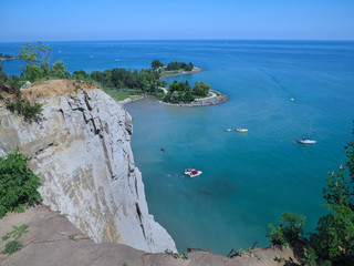 view from edge of the cliff at Scarborough Bluffs to park and lake below, Toronto