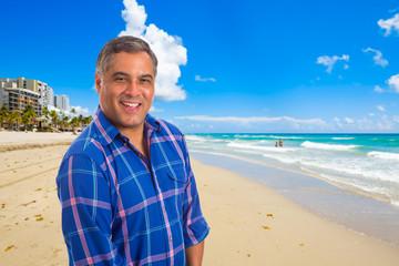 Handsome Hispanic man at the beach