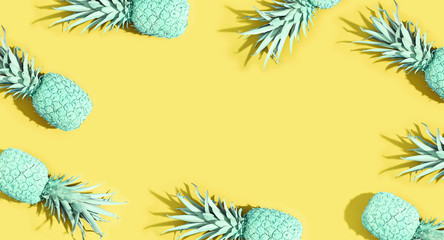 Painted pineapples on a vivid color background