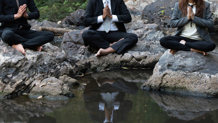 Meditation of business people in nature environment for benefits.