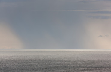 Spoed Foto op Canvas Nachtblauw Raining on the ocean