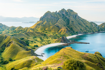 View of Padar Island in a cloudy evening with blue water surface and tourist boats, Komodo Island (Komodo National Park), Labuan Bajo, Flores, Indonesia