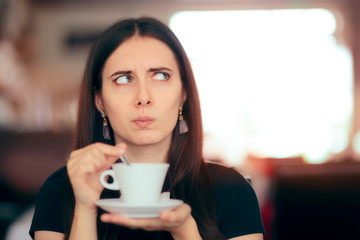Surprised Woman Drinking Coffee in a Restaurant