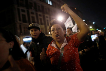 Supporters of presidential candidate Andres Manuel Lopez Obrador celebrate in Mexico City