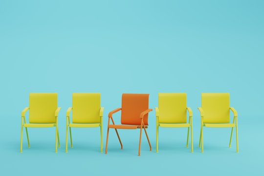 red chair and yellow chair in light blue room.