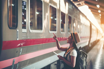 Girl traveling the tourist train station, Active and travel lifestyle concept