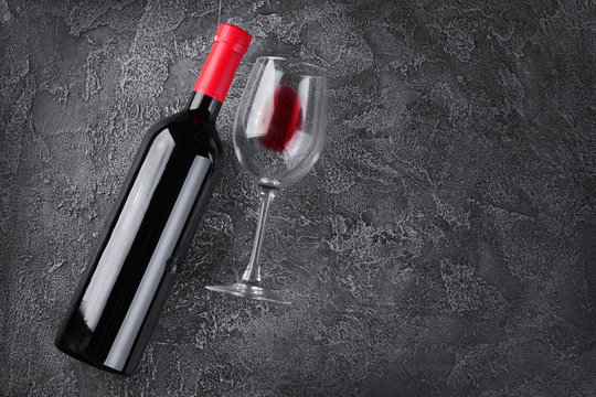 Flat lay with lying red wine bottle and glass for tasting