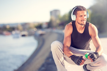 fitness man taking a break after jogging