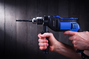 Male hands holding power drill