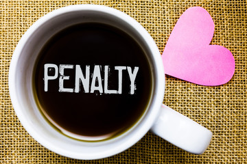 Text sign showing Penalty. Conceptual photo Punishment imposed for breaking a law rule or contract Sports term Tea time coffee cup office typing work jute rough background love heart.