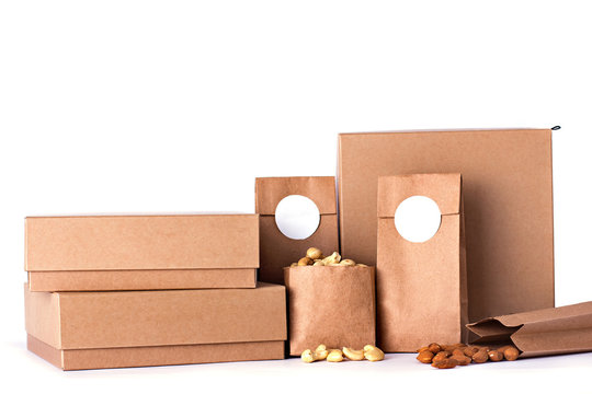Kraft bags and boxes with nuts.