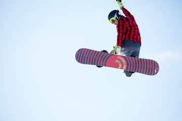 Image of young athlete jumping with snowboard