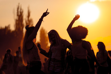 Sunset party dancers silhouettes at summer music festival