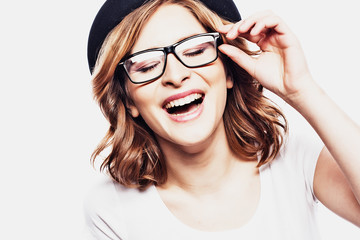Happy  young student woman  in fashion glasses and black  hat on white background