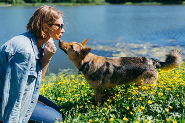 Picture of woman with dog near pond