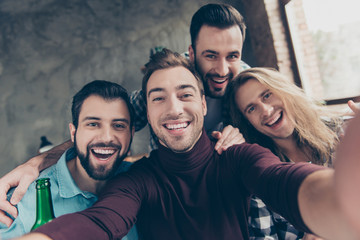 Self portrait of four attractive, confident, successful, funny guys with modern hairstyle making selfie with two hands on mobile phone, front camera, community spending great time