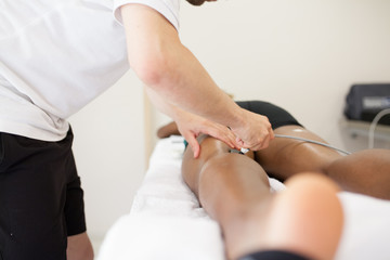 physiotherapist applying massage