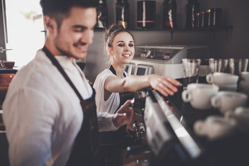 Fototapeta Cafe business, professional baristas team during work at cafe obraz