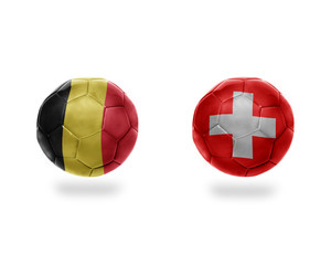 football balls with national flags of belgium and switzerland.