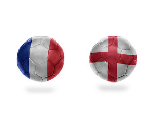 football balls with national flags of france and england.