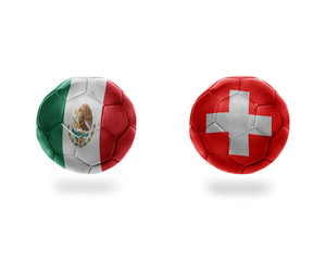 football balls with national flags of mexico and switzerland.