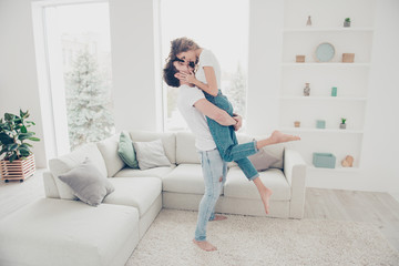 Full size portrait of lovely romantic partners in denim clothes enjoying holiday together in modern living room. Harmony idyllic leisure weekend concept
