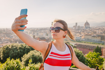 Tourist taking selfie with Florence cityscape Tuscany Italy