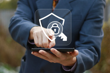 Wall Mural - Businessman presses button locked shield security icon on phone virtual electronic user interface