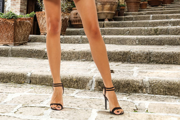 slim woman legs and blakc heels