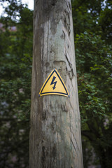 Electricity sign on wooden post