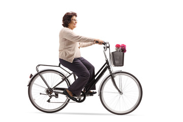 Mature woman riding a bicycle