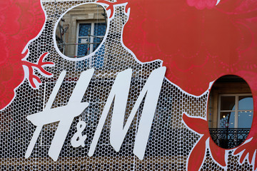 The logo of the Swedish fashion retailer Hennes & Mauritz AB (H&M) is seen outside a store in Paris