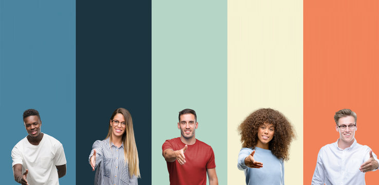Group of people over vintage colors background smiling friendly offering handshake as greeting and welcoming. Successful business.