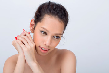 Close up of beautiful asian young woman with V Shape face and touch her face, Copy space for text or product