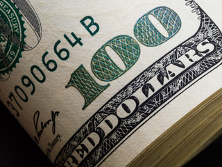 Macro shot of a 100 dollar. Dollars Closeup Concept. American Dollars Cash Money. One Hundred Dollar Banknotes
