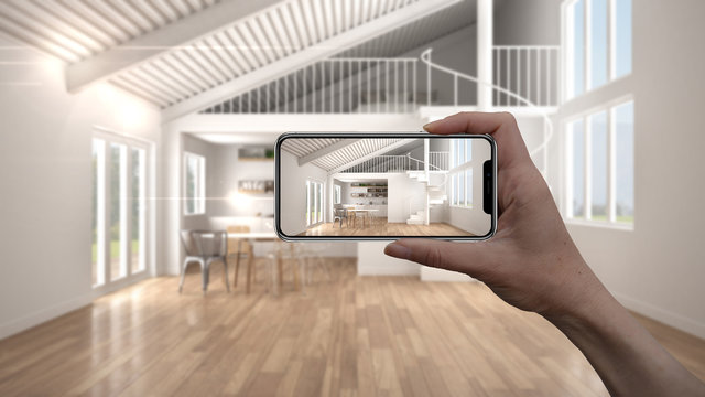 Hand holding smart phone, AR application, simulate furniture and interior design products in real home, architect designer concept, blur background, modern living room with kitchen