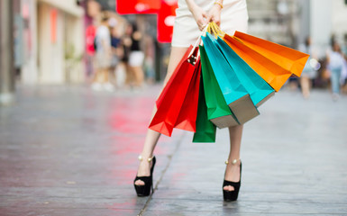 Beautiful Shopping woman with colorful shopping bags walking in the mall. Happy woman concept.