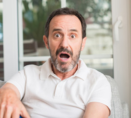 Handsome middle age man scared in shock with a surprise face, afraid and excited with fear expression