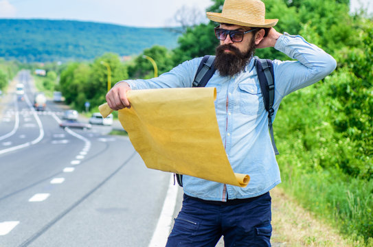 Find direction map large sheet of paper. Where should I go. Tourist backpacker map lost direction travelling. Around the world. Map allow recognize enough details to walk somewhere if get lost
