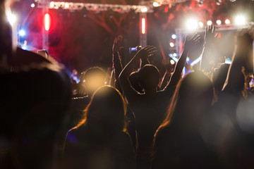 Audience take a photo on mobile phone at a free night concert music festival.