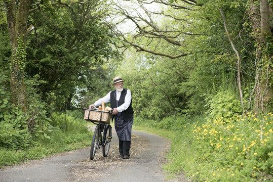 1940 delivery man on a country road rural setting