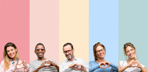 Mixed group of people, women and men happy showing love with hands in heart shape expressing healthy and marriage symbol Wall mural