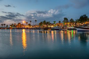 Side harbor and skyline after sunset