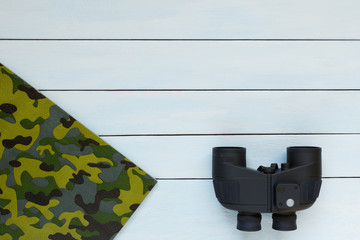 Binoculars on a wooden background.