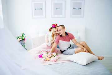 A nice couple hugging on the bed