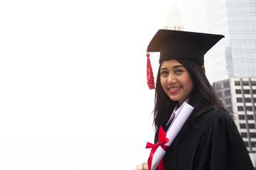 Beautiful Graduate graduates woman smile and are happy after graduation.