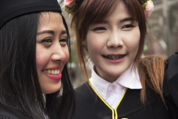 Beautiful Graduate graduates woman smile and are happy after graduation..