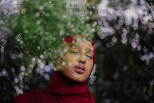 Girl in hijab under tree