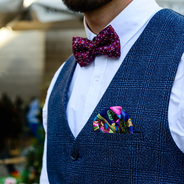 Unknown stylish groom with nice handkerchief in a jacket pocket,
