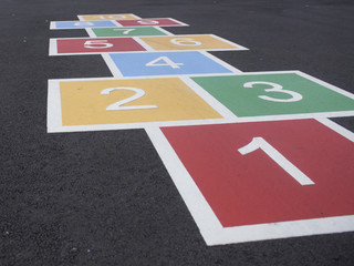 Colorful Hopscotch on Blacktop in a Park